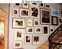 hanging photos by staircase